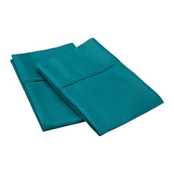 "600 Thread Count Cotton Rich King Ivory Pillowcase Set, Teal - Our 600 Thread Count Cotton Rich Pillowcase set is a superior quality blend of 55% Cotton and 45% Polyester making these duvets soft, wrinkle resistant, and easy to care for. Set includes two pillowcases 20""x40"" each."