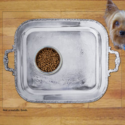 Sniff It Out Designer Pet Mat - Silver Tray Pet Food Mat, Large - Not a Metallic finish. Premium-quality clear vinyl mats uniquely designed to resemble beautiful art painted directly onto your floor. The smoothness of the vinyl allows for easy cleanup and lays perfectly flat. Sniff It Out Pet Mats make great gifts and will be a conversation piece that your friends and family won't stop talking about. Made in the USA.
