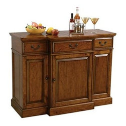 Howard Miller - Howard Miller - Shiraz - This charming Hide-A-Bar�� console cabinet is finished in Indian Summer Oak accented with matching antiqued hardware. The bar presents a traditional fa̤ade with plank style top that tastefully conceals generous storage drawers and shelves for wine, liquor and bar accessories. * This Hide-A-BarT console has raised door panels and offers generous room for wine and spiritsEach side features an adjustable shelf and storage on the inside of each doorThe center of the cabinet features a lazy susan style pivoting door with two fixed shelves providing additional room for bottle and glass storageThe top is a planked style look with a hand planed surface and various forms of distressingThree upper drawers hold serving utensils, bar cloths and other itemsFinished in Indian Summer on select hardwoods and veneersAdjustable levelers under each corner provide stability on uneven and carpeted floorsPad-LockT cushioned metal shelf clips increase stability and safetyLocking door for added securityHanging stemware rack keeps stemware handy38 in. H x 50.75 in. W x 21.25 in. D