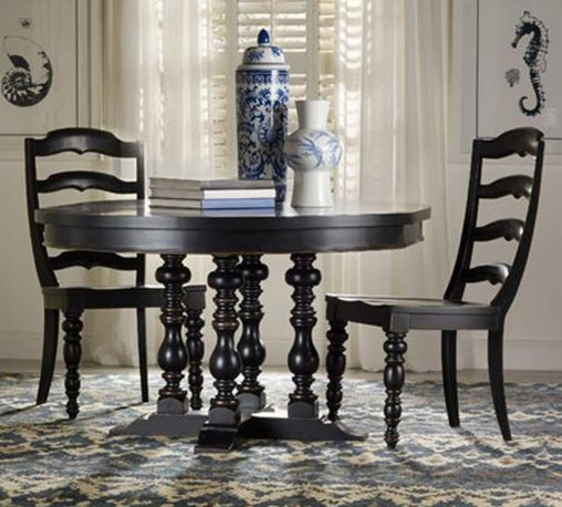 Hooker Furniture - Hooker Beaufort Ladderback Dining Side Chair - Black - Set of 2 - HOOK2380 - Shop for Dining Chairs from Hayneedle.com! Laid back yet upscale bold and welcoming the Hooker Beaufort Ladderback Dining Side Chair - Black - Set of 2 seats dinner guests in high style. A detailed ladderback design extravagantly turned front legs and tapered slightly flared back legs offer elegant stability. Generous contoured seats and backs provide supreme comfort. This set includes two side chairs built to last from rubberwood and poplar solids with maple veneers over engineered wood. The black finish is hand-applied in a 16-step process that ensures a smooth finish.About Hooker Furniture CorporationFor 83 years Hooker Furniture Corporation has produced high-quality innovative home furnishings that seamlessly combine function and elegance. Today Hooker is one of the nation's premier manufacturers and importers of furniture and seeks to enrich the lives of customers with beautiful trouble-free home furnishings. The Martinsville Virginia based company specializes in lifestyle driven furnishings like entertainment centers home office furniture accent tables and chairs.Construction of Hooker FurnitureHooker Furniture chooses solid woods and select wood veneers over wood frames to construct their high-quality pieces. By using wood veneer pieces can be given a decorative look that can't be achieved with the use of solid wood alone. The veneers add beautiful accents of color and design to the pieces and are placed over engineered wood product for strength. All Hooker wood veneers are made from renewable resources and are located primarily on the flat surfaces of the furniture such as the case tops and sides.Each Hooker furniture piece is finished using up to 30 different steps including 13 steps of hand-sanding and accenting. Physical distressing is done by hand. Pieces receive two to three coats of solid lacquer to create extra depth and add durability to the finish. Each c