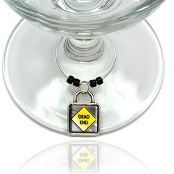 "Made on Terra - Dead End Stylized Yellow Grey Road Sign Wine Glass Silver Charm - Your guests have arrived and the atmosphere is electric. A sip of wine here, a sip of a cocktail there and you find the conversation turning to the charming baubles you've placed on the glasses, something special you chose for each of your eclectic guests. They love them and appreciate your thoughtfulness. You love them for their uniqueness and that no one forgets which glass they were using.  Choose from Made on Terra's many designs for the best party ever. Ring is 1"" diameter; measures 2"" from top of ring to bottom of charm. Made of metal and plastic. Sold individually."