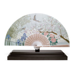 "Lladro Porcelain - Lladro Iris And Cherry Flowers Fan Figurine - Plus One Year Accidental Breakage - "" The piece is conceived to be displayed with a device that allows it to be wall-hanged with the hooks on its backboard and leaving the base apart, or just displayed on the wooden base attached. Classic glazed porcelain with the traditional colours of Lladro but also using enamels (tree branch) and intense attractive colours (blue iris). The flat surface allows our artists to offer a scenery view as if it were a canvas for a painting. The composition is similar to the classical vases, but allows to watch every detail at one time. Hand Made In Valencia Spain - Limited To: 2000 Pieces Worldwide - Included with this sculpture is replacement insurance against accidental breakage. The replacement insurance is valid for one year from the date of purchase and covers 100% of the cost to replace this sculpture (shipping not included). However once the sculpture retires or is no longer being made, the breakage coverage ends as the piece can no longer be replaced. """