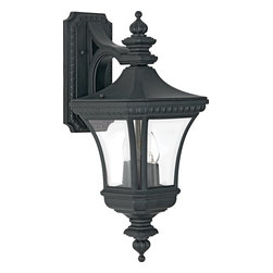 Quoizel - Quoizel Devon Transitional Outdoor Wall Sconce X-K9048ED - Elegant finials, cut-corn detailing at the back plate and traditional beveling throughout help to create a refined, ornate appearance to this Quoizel Lighting outdoor wall sconce. This transitional wall sconce from the Devon Collection incorporates clear beveled glass panels and a mystic black finish that highlights the finer details.