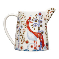 iittala Taika Pitcher 17 oz White - Iittala Taika is part of the whimsical Taika series, illustrated by Klaus Haapaniemi for Iittala in 2007. Available in white, blue and black the design draws upon folklore for a fanciful design that is visually stunning. Taika means 'magic' in Finnish and the classic forms designed by Heikki Orvola combine well with other Iittala collections, brings a playful magic to your table.