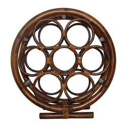 "Used Vintage Round Rattan Wine Rack - A wheel of wine... wheeee! This rattan accent piece would fit into any decor, adding a bit of vintage style to your bar or dining room. It holds 7 bottles of wine or can be used creatively as a magazine rack or holding hand towels.    Measurements:  16"" tall  15"" wide"