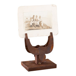 Spurred On Photo Clip - Your family's old photos or travel memorabilia get a rugged, but reverent, space resting in this antiqued photo clip. Its rusty iron finish is a cool way to bring some tough Southwestern style to your space.