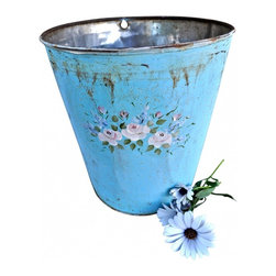 "Sap Bucket - Vermont sap buckets were hung on the maple trees for sugaring.This one is hand painted with soft pale pink flowers on a beautiful blue bucket. The artist no longer paints on these vintage buckets so they are truely special.The conditon is very good...Measurments: 8""6 x 9""6"