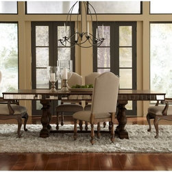 Pulaski - Pulaski Alekto Trestle Dining Table with Mirrored Apron - Aged Patina - 201009 - Shop for Dining Tables from Hayneedle.com! The Pulaski Alekto Trestle Dining Table with Mirrored Apron Aged Patina offers refined dining style at its best. With a mirrored apron it provides a touch of flamboyance to make a statement piece. It works well in spaces with heritage themes as well as rustic chic decor.Expertly crafted with select solid hardwoods and veneers this table will provide elegant dining for your family for generations to come. The aged patina finish softens the aesthetic while a mirrored apron adds glamour and intrigue. The double trestle base features four turned legs and a stretcher that doubles as a footrest. A 20-inch leaf provides seating for up to two more people making this table perfect for intimate dinner parties.About Pulaski FurnitureFounded in 1955 in Pulaski Va. and taking the name of the town as its own Pulaski Furniture was originally established as a maker of bedroom and dining room furniture. Recently celebrating its 50th anniversary Pulaski Furniture is one of the top 40 furniture importers in the United States. Now a division of Home Meridian International Pulaski Furniture Corporation continues to outperform with stylish and innovative product development designing and building a broad selection of collectors cabinets accent pieces and bedroom and dining furniture for your lifestyle needs.