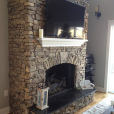 Eclectic Fireplaces by Total Quality Home Builders, Inc.