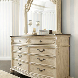 American Drew - American Drew Jessica McClintock Boutique 8 Drawer Dresser w/ Mirror in White Ve - Jessica McClintocks simply romantic personal style is the inspiration for this extensive collection of richly ornamented and detailed pieces for the home.The eclectic blending of materials and finishes adds even more romance and designer touches. The collection is crafted from Oak and Pecan Veneers  Silver Leaf  Metal and Marble.The main finish  White Veil  is an antique white wash that allows the wood grain to show through and has aged/distressed detailings. On most White Veil pieces the tops are done in our Revival finish. This is a raw  scrubbed finish on Pecan veneers that emulates an antique that has been stripped of its original finish.
