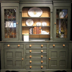 British Traditions - Large Fancy Country Sideboard & Hutch w Multiple Drawers & Cabinets (French Gray - Finish: French Gray. Each finish is hand painted and actual finish color may differ from those show for this product. Large fancy country hutch. 2 Fretwork glass cabinets top. 3 Fixed display shelves. 2 Lower cabinets. 7 Drawers. Minimal assembly required. Top cabinet size: 20 in. W x 10 in. D x 40 in. H. Center shelf size: 30 in. W x 6 in. D x 40 in. H. Grooved for plate display. 84 in. W x 19 in. D x 85 in. H (388 lbs.)This hutch is charming and has detail from top to bottom. The top has two side cupboards with glass doors, three adjustable shelves in each side, and wooden fretwork. The bottom has five small drawers down the center. There are two cabinets in the base with doors detailed with four square mouldings that give this piece a signature look.