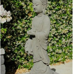Sakyamuni Buddha Garden Statue - A beautiful representation of Siddhartha Gautama, the Sakyamuni Buddha Garden Statue stands on a beautifully detailed, primitive knotted base. Handcrafted from solid cast stone in the US, this garden statue features integrated coloring and is sealed for outdoor use. Available in your choice of finish, you'll love having this statue in your garden. About Designer StoneSince 1999, the family-owned Designer Stone has been proudly manufacturing American made garden variety stoneware in a creative range of prices and functions for every standard of living. With artist designed sculptures and planters, Designer Stone's aim to create spiritually moving and enlivening pieces intends to evoke the precious moments from a garden that remind us who we are and what we do. With every purchase backed by a no-hassle guarantee, Designer Stone promises high-quality products that will enhance your home or garden, no ifs ands or buts.