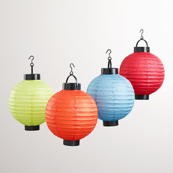 World Market - Multicolored Battery-Operated Paper Lanterns, Set of 4 - Full of illuminating style, our fun Multicolored Battery-Operated Paper Lanterns now feature improved energy-saving bulbs lasting up to 500 hours. Our chic lanterns are portable, affordable and easy to store. With no need for electrical outlets, these long-lasting lights are perfect ambient accents for gatherings and special events indoors or out. Coordinate them with our matching outdoor cushions, umbrellas and more.