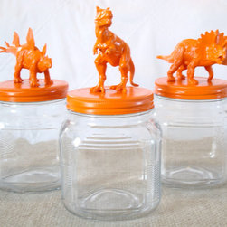 Orange Dinosaurs Jars by Juxtaposition - Just spray paint animals an eye-popping color and glue them to a lid to DIY the perfect cookie jar.