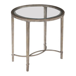 Magnussen - Magnussen Copia End Table in Antique Silver - Magnussen - End Tables - T211407 - This end table from Modern Horizons will enhance the beauty of your decor. Its contemporary decor style features an oval-shaped tempered glass top. The shimmering antique silver frame greatly complements the table. This table can be placed beside your sofa and you can add a couple of decorative accessories like candles vases for a creative touch. It is perfectly suitable for a neutral colored theme in gray and beige shades.