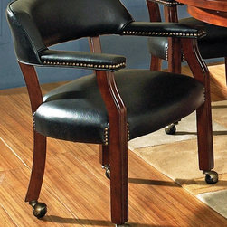 Steve Silver Co. - Tournament Chair w Casters (Black) - Choose Upholstery: BlackComfortable padded seats and backs. Decorative nail head trim. Upholstered in a durable leather. Highly detailed woodworking, intricate carvings. Tongue and groove Joints. Traditional style. Corner block construction. Multi step rich cherry finish. Seat height: 18 in.. Overall: 25 in. W x 25 in. D x 31 in. H (30.5 lbs.)