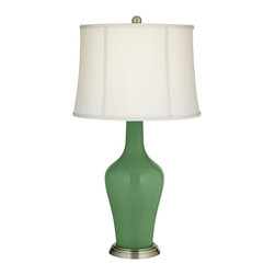 """Color Plus - Traditional Garden Grove Anya Table Lamp - Infuse your home with the fresh designer color of this glass table lamp from our Color + Plus™ lighting collection. The lamp is hand-crafted and made-to-order by experienced artisans in our California workshops and features a beautiful Garden Grove color. It rests securely on a brass finish metal base and is topped with a chic off-white softback drum lamp shade.  Garden Grove designer color table lamp.  Off-white softback drum lamp shade.  Antique brass finish base.  Metal and glass construction.   Maximum 150 watt or equivalent bulb (not included).  On/off switch.  Shade is 15"""" across the top 17"""" across the bottom 12"""" high."""