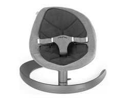 Nuna Leaf Curv Baby Swing - There's nothing more beautiful than rocking your baby to sleep, except for maybe watching your baby rock to sleep in a Nuna Leaf Curv Baby Swing, so you can get stuff done. Introducing a new baby into your home shows you just how full days are with previously simple tasks. Small household chores that used to take only a minute or two no longer fold seamlessly into your day when you have to complete them all one handed, or occasionally without any hands at all. This adorable child's swing gives you your hands back so you can stay on top of your life.Set at a perfect angle for either napping or attentively playing or observing, this seat comfortably secures your tot with an easily adjustable 3-point Velcro safety belt. While the mesh backing prevents overheating with its breathable support, the Oeko-Tex fabric and lightweight organic cotton insert offer a comfy, plush surface that your child will love snuggling into. The swivel-motion lock also makes this a great chair for playtime and meal time, keeping them steady so they can focus on the task at hand.The nature-inspired design has both a visual and functional appeal. Your little sprite will look adorable cozied down in the leaf-shaped seat that you won't feel compelled to hide away when company calls, because its soothing, attractive Cinder color has a stylish versatility that will match your own tasteful decor. And the motion-driven motor uses simple, natural momentum rather than noisy and expensive electrical power. A quick gentle push provides over two minutes of kinetic propulsion that will lull your child to sleep. Sustainability doesn't just mean not using extra energy, however; it also means investing in products that last. This swing is designed to grow with your child (all the way up to 130 lbs.), so you won't have to stow it away for the next kid after just a few months of use. Even when your little baby is no longer a baby, she or he will love climbing back into this rocker to