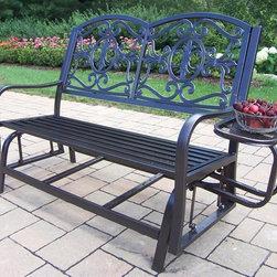 Oakland Living - Double Glider with Side Tray - Durable tubular iron construction. Metal hardware. Fade, lightweight, chip and crack resistant. Warranty: One year limited. Hammer tone bronze hardened powder coat finish for years of beauty. Minimal assembly required. 48.5 in. L x 23 in. W x 37.5 in. H (54 lbs.)The Oakland Rochester Collection combines practical designs and modern style giving you a rich addition to any outdoor setting. The traditional straight pattern work is crisp and stylish. Each piece is hand cast and finished for the highest quality possible. This glider will be a beautiful addition to your patio, balcony or outdoor entertainment area. Our gliders are perfect for any small space or to accent a larger space.