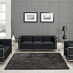 Charles Petite LC2 Black Leather Sofa Set - $2402.96 - The externalized tubular steel frame and chic black leater of the iconic Le Corbusier LC2 Sofa Set became the first to develop a new plan for modern living. The Le Corbusier LC2 series is the choice for living rooms, hotels, reception areas, restaurants and other lounge spaces. Set includes Le Corbusier LC2 Sofa, Loveseat and Armchair.