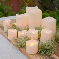 Flameless Resin Candles with Amber or Color Change Options, Set of 12 - This versatile set of 12 resin candles are perfect for indoor and outdoor use. The variety of sizes makes it easy to set any mood. Whether grouped or spread around a space, this set of battery operated candles offers a great lighting option for an event or as an alternative to standard home lights. Adding to the versatility given by the range of sizes included, each flameless candle features the option to choose between a flickering amber light or a slow fade, color changing option.