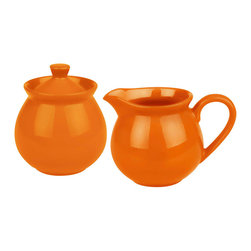 Waechtersbach - Creamer and Sugar Set Fun Factory Orange - Complete your coffee or tea service with this Fun Factory Orange Sugar and Creamer. With their vibrant color and contemporary shape, these must-have kitchen accessories will look lovely on your table. Sugar bowl includes lid.