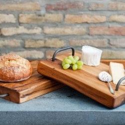 Wooden Farmhouse Cutting Board with Iron Handles - Hand crafted by artisans in Hungary, the classic lines of each board are accentuated by their sturdy wrought iron handles.