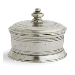 Roma Small Round Box - The Roma Small Round Box is an unmistakably European accent in vintage pewter, its symmetrical turns and simply cut-in decorative rings accenting a pared-down shape. The high knob in the center of the lid allows lifting of the lid. The materials of this metal trinket box are the finest that traditional craftsmanship has to offer e traditional Italian pewter and mouth-blown glass e and the quality of these elements shows even in such a small home accent.