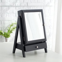 Easel Table Top Jewelry Box w/ Linen Lining - Black - 11W x 16.3H in. - Handsome and handy, the Easel Table Top Jewelry Box w/ Linen Lining - Black - 11W x 16.3H in. is a smart way to store your favorite jewelry pieces. With its artist easel look and handsome black finish, you'll be happy to display this jewelry box anywhere. Open the beveled mirror front to reveal a linen-lined interior with ring rolls, three jewelry hooks, and a handy pouch to keep everything organized. A storage drawer below offers even more space. Dimensions: EXTRA 20% OFF! Use code JEWELS. Limited-time offer. Top drawer: 7.9W x 4.9D x 1.3H inches Mirror: 7.5W x 9.75H inches Ring holder rows: 8L inches