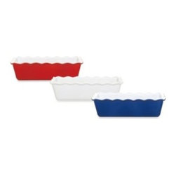 Emile Henry - Emile Henry Ruffled Edge Loaf Pan - The unparalleled heat distribution of this pan's special construction helps insure that your recipes succeed. The quality ceramic resists chips and cracks, with a durability that allows direct transfer from oven to freezer, if needed.