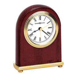 "Howard Miller - Rosewood Stained Hall Mantel Clock with Brass - Finished in Rosewood Hall, this simply elegant table top clock will fit in anywhere. A white dial with triple rim add that touch of extra. The black hour and minute hands, brass alarm and second hands give great contrast right where you need it. With a brass finish base and four rounded legs, it will stand up and stand out. * White dial with triple rim, brass finished bezel, black hour and minute hands, brass alarm and second hands. . Finished in Rosewood Hall on select hardwoods and veneers. . Quartz, alarm movement includes battery. . H. 5"" (13 cm). W. 4"" (10 cm). D. 1-1/2"" (4 cm)"