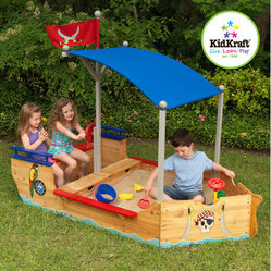 "KidKraft - Pirate Sandboat - Shiver me timbers! The young swashbucklers in your life are sure to love this sandboat's detailed design and fun artwork. Features: -Two convenient storage compartments for keeping buckets, shovels and other sand toys together in one place. -Steering wheel. -Colorful pirate - themed artwork. -Shady canopy helps keep kids in the shade and out of the hot sun. -Large enough that multiple children can play at once. -Made of wood. -Sturdy construction. -Packaged with detailed, step - by - step assembly instructions. -Overall Dimensions: 58.7"" H x 75.7"" W x 43.8"" D."