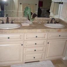 Mediterranean Bathroom Vanities And Sink Consoles by Arvizu Contracting