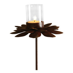 Rust Flower with Stake - Perfect for creating a mellow, inviting mood in door-flanking planters or backyard garden beds, as well as for romantically outlining a path, the Rust Flower with Stake sets a glass votive cup atop a beautiful zinnia made from forged iron. Individual petals form a gorgeous array around the enchanting glow of a tealight, creating a chic garden fantasy in a vintage ferrous patina.