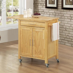Sunset Trading - Sunset Trading Vermont Kitchen Cart - Natural Multicolor - GRM-CRT-VER-NN - Shop for Carts from Hayneedle.com! Finding what you need in the kitchen should never be an issue with the Sunset Trading Vermont Kitchen Cart - Natural. Featuring a convenient mobile design this versatile kitchen cart offers easy access to your cooking items with a variety of storage options. It includes an open shelf for storage or display a cabinet for hidden storage a utility drawer a drop leaf and three hooks for cups or utensil storage. Made from eco-friendly Malaysian hardwood the Vermont kitchen cart has a natural wood base and top and stainless steel hardware. Dimensions: 40.5L x 19W x 31.5H inches. About Sunset TradingThis product is designed and manufactured by Sunset Trading. Located in Londonderry New Hampshire Sunset Trading creates high quality furniture for bedrooms living and dining rooms. Their furniture features side roller drawer guides four corner English dovetails solids and veneers. Dining rooms feature epoxy resin constructed chairs with metal support brackets which make their chairs 100 times stronger than glued chairs. Rest assured you're making an excellent choice when you purchase a fine furniture item from Sunset Trading.