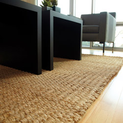 Patagonia Jute Rug - Jute brings a magnificent, chunky texture to any space. These rugs are expertly handloom-woven by skilled weavers who employ a variety of traditional techniques to create these simply beautiful styles. Jute fibers exhibit naturally anti-static, insulating and moisture regulating properties. It is predominantly farmed by approximately four million small farmers in India and Bangladesh and supports hundreds of thousands of workers in jute manufacturing (from raw material to yarn and finished products). Flat braided jute technique.