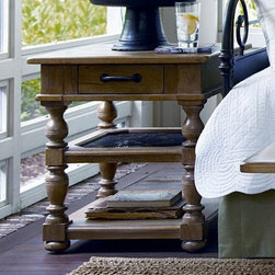 Paula Deen Down Home Rectangle Oatmeal Wood End Table with Drawer - Curvaceous, turned legs and a whimsical screen door shelf detailing make the Paula Deen Down Home Rectangle Oatmeal Wood End Table with Drawer your new favorite piece. Not just good looking, this end table is well-crafted of poplar veneers and select hardwoods in a friendly oatmeal finish accented by a dark metal drawer pull. Plenty of space for display pieces, it features two lower shelves as well as a small storage drawer and spacious top. About Universal Furniture InternationalRecognized as a leader in exceptionally crafted home furnishings, including bedroom and dining room items, entertainment centers, and more, Universal strives to make items that are styled to endure but always remain fresh. They make it a goal to include features that fit the way their customers live today, and to find prices that put high-quality products within reach. These are the principles that guide the work at Universal, essential elements of good, affordable, and smart design.