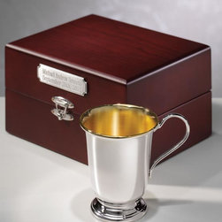 """Exposures - Sterling Silver Empire Cup with Presentation Case and Plaque - Overview Designed exclusively for Exposures, this sterling silver cup by Carrs of England is the ultimate heirloom gift. Display to commemorate a new baby, wedding, retirement or lifes other milestones. Carrs silversmiths create world-renowned silverware, and this cup is an outstanding example.   Features Sterling silver Comes in mahogany presentation case lined in cream velvet  Gold wash on inside of cup Engraved antique silver plaque available for personalization Made in the U.K.    Personalization  Engraved antique silver plaque available; personalize with up to 3 lines, 20 characters per line   Specifications  Cup: 2 1/2""""dia. X 2 7/8"""" high Box: 6"""" wide x 4 3/4"""" long x 3 1/4"""" high"""