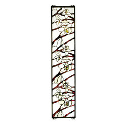 "Meyda Tiffany - 9""W X 42""H Magnolia Stained Glass Window - This Nature inspired window is an Original Meyda Tiffany design with Magnolia branches featuring White & Pale Amber pedaled blossoms, against a Clear textured background glass. The handcrafted window is created with 337 pieces of stained art glass utilizing the copper foil construction process, and framed in antiqued brass. This beautiful Tiffany style window comes with hooks on all four corners so it can hang either horizontally or vertically. Hanging chains, mounting brackets & screws are included."