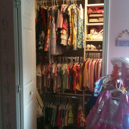 Olivia's Closet - This closet was designed for a little girl.  We needed space for clothes, shoes, AND some toys.  We took the rod and shelf down in this reach in closet, and upgraded it to triple rods, lots of shelves, and a few belt holders. This six-year old can now reach the bottom two rods, so Mom is happy that she's hanging up her own clothes!