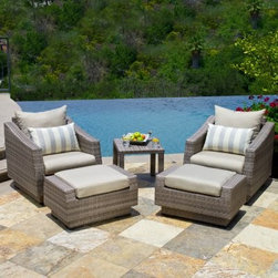 RST Outdoor Cannes Slate 5 Piece Club Chair and Ottoman with Side Table - The RST Outdoor Cannes Slate 5 Piece Club Chair and Ottoman with Side Table give you the perfect opportunity to relax and enjoy being outdoors while surrounded by the peace and serenity of your own yard. Beautifully designed, this sophisticated set is crafted from gorgeous, hand-woven polyethylene (PE) wicker over a strong, lightweight, and rust resistant aluminum frame in a rich, powder coated bronze color. Its elegant grey wicker is perfectly accented by the soft and comfortable Sunsharp Slate Grey cushions. Made from breathable fabric that is easy to clean, these cushions are made to dry quickly to help avoid mildewing. UV-, fade-, and weather-resistant, this set is made to hold up great in salty and chlorinated environments, making it ideal for pool and seaside relaxing. PE wicker is cool to the touch, even in hot weather, making it a comfortable place to relax at anytime of the day. Made from 100% recyclable material, this set includes two chairs, two ottomans, and an end table that's perfect for holding your book or drink. Whether you're putting your feet up after a long day or spending some time on your laptop while working from home, you'll love having this elegant set as a part of your patio decor. Additional Features Chairs: 33W x 31D x 31H in.Ottomans: 31W x 20D x 17H in. End Table: 20L x 20W x 19H in. Comfortable cushions in beautiful slate grey Sunsharp outdoor cushions are fade-resistant Cushions are soft and comfortable Fabric dries quickly to avoid mildewing Fabric is easily removed for washing Sofa is crafted from 100% recyclable material PE wicker is cool to the touch even in hot weather Powder coated, textured, bronze-colored frame Chairs and ottomans arrive fully assembled Some assembly required for table About Red Star TradersSince 2004, Red Star Traders LLC (made up of RST Outdoor, RST Living and FlowWall System) has designed and manufactured products in the outdoor living, home decor and wall-based organizational products categories. Red Star is a direct import, product marketing company. Red Star categories of focus include jewelry boxes, men's gifts & furnishings, and RTA furniture. Their team of marketing and design professionals can help identify market trends and deliver products that meet target retails with maximum perceived value. Red Star's network of manufacturing partners and overseas production managers insure integrity in production and strict quality control.