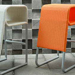 P Stool 2 by Lebello - P Stool from Lebello is a an all weather counter Stool suitable for outdoor and indoor environments. An open space underneath the seats accommodates hand bags, towels or magazines. The stool is available in two models P Stool 2 features a long leg cover in the back. The stool is finished peel fiber, available in a variety of colors. Designed by Lebello, 2007