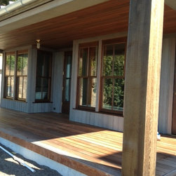 Robins Build on Chuckanut Drive - Custom Cut 12x12 Western Red Cedar Beams are used for structural support.  The siding is 1x8 Select Tight Knot Cedar Channel with a bleaching oil applied to speed up the graying process.  The decking is Ipe and the soffits are a custom cut Doug Fir T&G