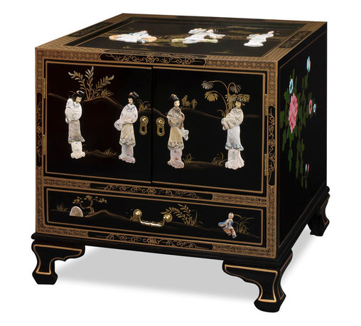 "China Furniture and Arts - Black Lacquer Pearl Figure Motif Lamp Table - In a distinctive 18th century style with Chinese figures crafted out of mother of pearl, this elegant lamp table with a traditional Chinese dance-of-the-maiden scene is fascinating to look at and practical to use. Designs continue on the top and sides of the table. One lower drawer has interior dimensions of 20.25""W x 15.25""D x 2.75""H and an interior compartment behind the two doors provides convenient storage space with dimensions of 23.25""W x 23.75""D x 12""H. Solid brassware ideally matches the gracefulness of the cabinet's sophisticated gold lines. A glass top is included making display of lamps or other objects ideal. (Assembled.)"