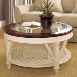 """Hammary - Promenade Round Cocktail Table in Fruitwood/Antique Linen Finish - """"The Promenade Series from Hammary offers a collection crafted of Pine Solids and Birch Veneers and feature a Fruitwood/Antique Linen finish. Promenade is inspired by European designs taken from utilitarian furniture. Influences of French, Scandinavian and English can be seen in each beautiful piece."""