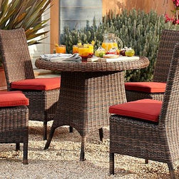 """Torrey All-Weather Wicker Round Bistro Table, 36"""" diam., Espresso - Wicker has been prized since ancient times for its durability, beauty and lightness in creating furniture. Our Torrey Collection captures the great qualities of natural wicker, but is actually made from a strong synthetic that stands up to all kinds of weather. The bistro table is hand made with a large arched apron and wrapped feet in a traditional basket weave. Click to read an article on {{link path='pages/popups/torrey-care_popup.html' class='popup' width='640' height='700'}}recommended care{{/link}}. 36.5"""" diameter, 30.5"""" high Frame crafted of welded aluminum and handwoven all-weather wicker. Woven from a durable synthetic that replicates the look and feel of wicker, but is remarkably resistant to sun, rain, heat and cold. Features tempered-glass top with an umbrella hole. Table accomodates an umbrella. Seats four comfortably. View our {{link path='pages/popups/fb-outdoor.html' class='popup' width='480' height='300'}}Furniture Brochure{{/link}}."""