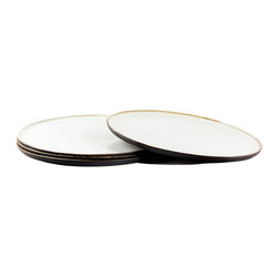 Black and White Dinner Plates – Set of 4 - These simply beautiful earthenware dinner plates are elegant and unusual.  They are each slip-cast by hand in black clay and the outside is left unglazed, offering a unique tactile and visual contrast between the matte exterior and the light glossy white interior.  Fired at stoneware temperature, they are food-safe, dishwasher and microwave safe. The nature of the clay and Diana's technique make each item distinctly unique, giving each a personality of it's own.  Handmade in South Africa.
