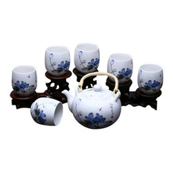 Painted Peace - The Tea Set, Blue Flower - these beautiful sets of porcelain tea ware are hand painted by trained artisans with age old traditional techniques, making each piece a one of a kind work of art.