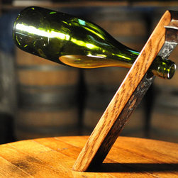 Wine Accessories - This simple yet intriguing design will wow any guests. Created from recycled Oak wine barrel the weight of the bottle counteracts gravity to suspend itself.