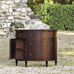 Ballard Designs - Varese Demilune - Crafted in Italy of solid hardwood & fine veneers. Marbleized paper drawer liners. Two outer drawers pivot open above elegantly curved doors. Soft close drawer glides now included. Its lovely demilune shape, flush panel design and antique brass teardrop pulls lend a decidedly formal look to any room. Three center drawers flanked by two drawers and two cabinets with one shelf each provide ample storage. Part of our exclusive Casa Florentina collection, it's available in your choice of several hand-applied finishes. Skilled Italian artisans apply your custom finish in layers, distressing each one by hand using the same simple tools and techniques employed by Florentine artists for centuries.Varese Demilune features: . . . .